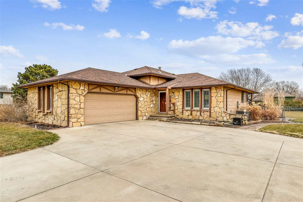 Don't miss this 4 bedroom, 3 bath home sitting on a .92 acre beautifully landscaped lot!  You will b