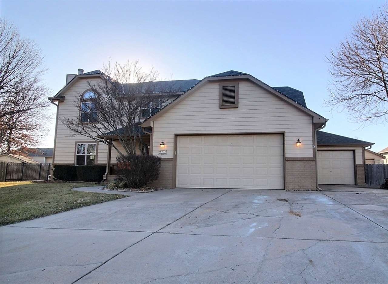 This 5 bedroom, 3.5 bath home with 4 car garage plus a large storage shed in the heart of Derby is a