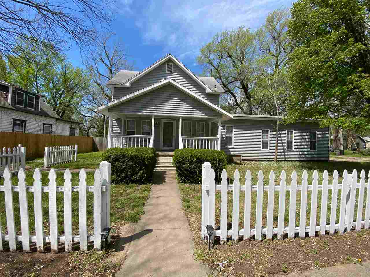 This is a find! Gorgeous two story with many recent updates including Brand New Roof make this a move in ready home! You will immediately notice the white picket fence, front porch and curb appeal when you arrive! Inside you will find freshly updated floors throughout and spacious and large living room! The kitchen is nicely updated and completed with all stainless appliances and a formal dining area! You will also find a huge master suite on the main complete with walk in closet, updated bathroom and plenty of extra space for a home office or workout area! On the upper level you have another bathroom and 3 large bedrooms! Outside you will find a nice large deck, huge backyard, and storage shed! The property has nice mature trees and the fencing offers plenty of backyard privacy! Don't miss out! Call the listing agent today to schedule a showing!
