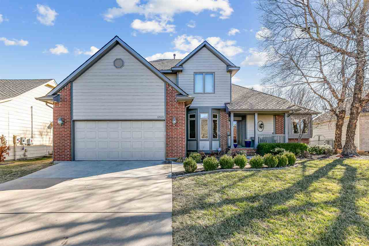This beautiful 1.5-story home is in the desirable White Tail neighborhood in the Andover school dist