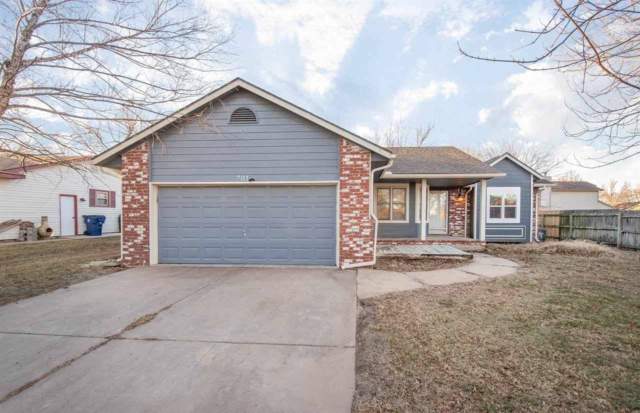 5 Bedroom + bonus room ranch in Colwich!  Walk into the living area with vaulted ceilings & a wood b