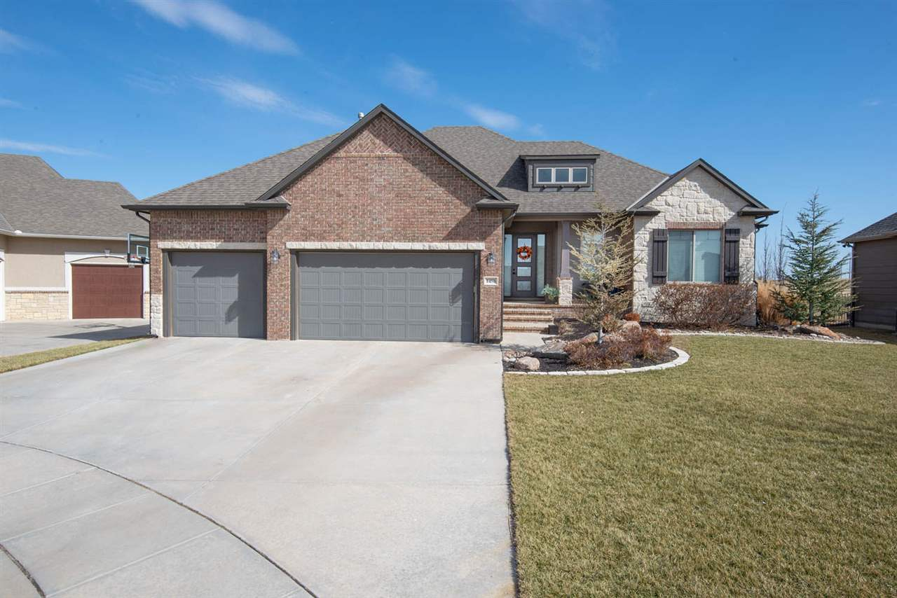 5 BED, 5 BATH, OPEN SPLIT, WALK OUT RANCH HOME ON THE DERBY COUNTRY CLUB FAIRWAY!  THIS IS A CRAIG S