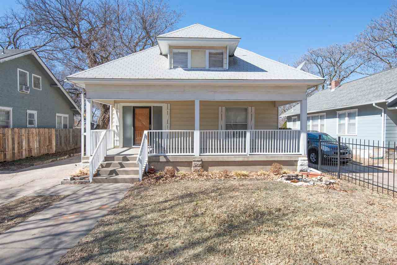SPACIOUS BUNGALOW IN SOUTH WICHITA,  2 Bedroom, 1 BATH with walk in shower, hardwood flooring, and a