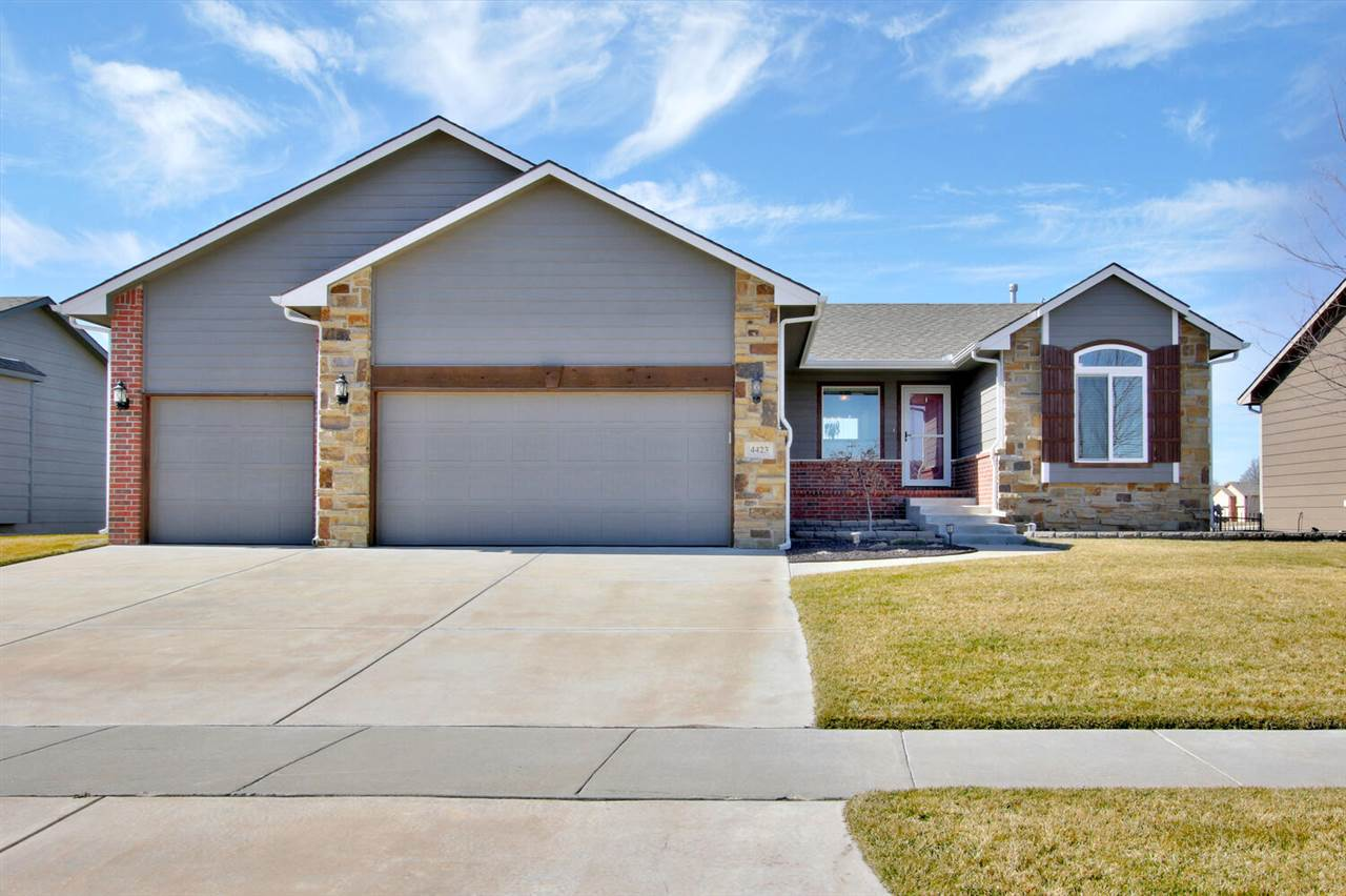 This beautiful home is located in the desired Maize School District.   9' vaulted ceilings through t