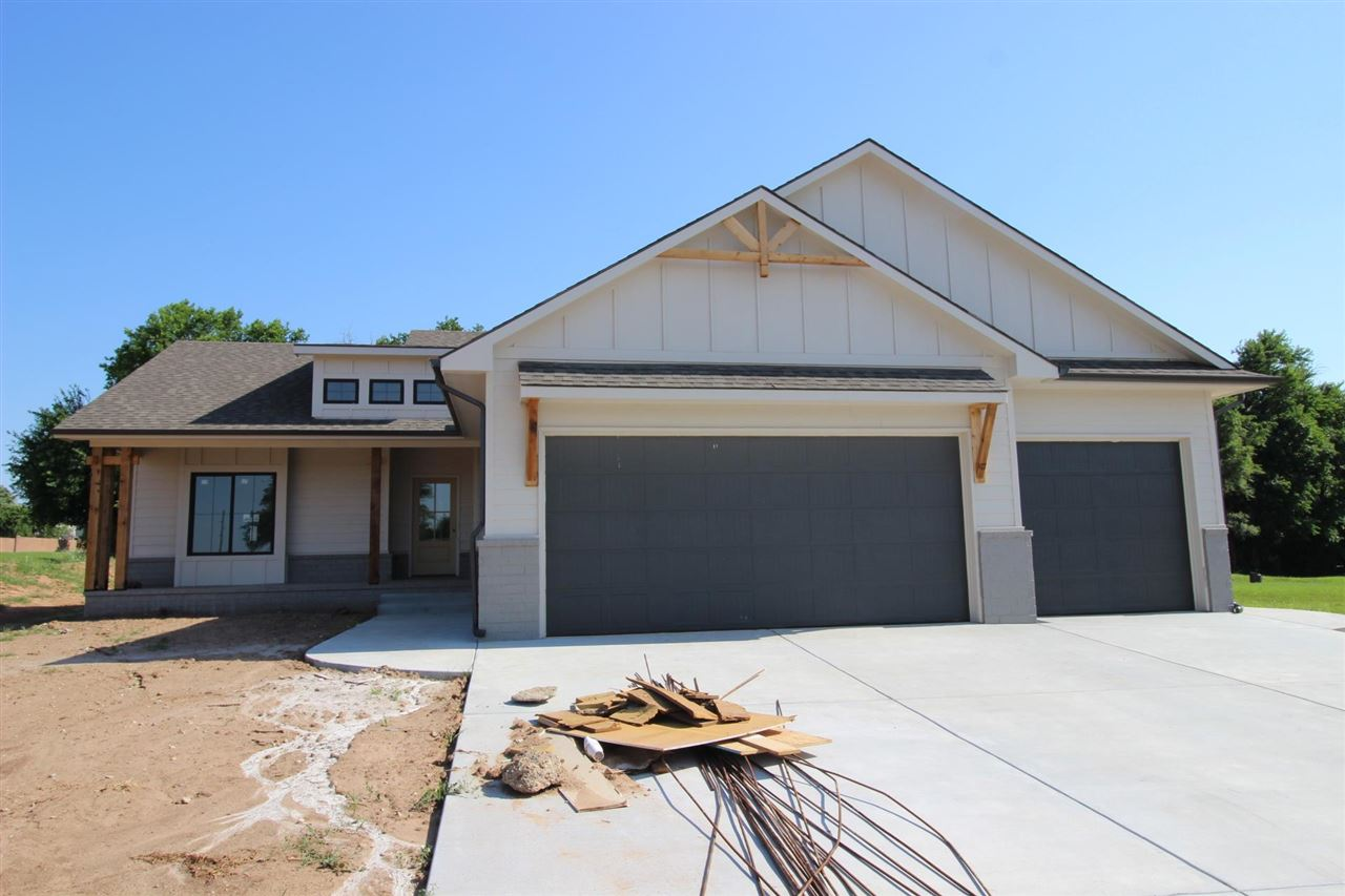 Quality workmanship shines through with this ranch style home with open floorplan in the heart of Mu