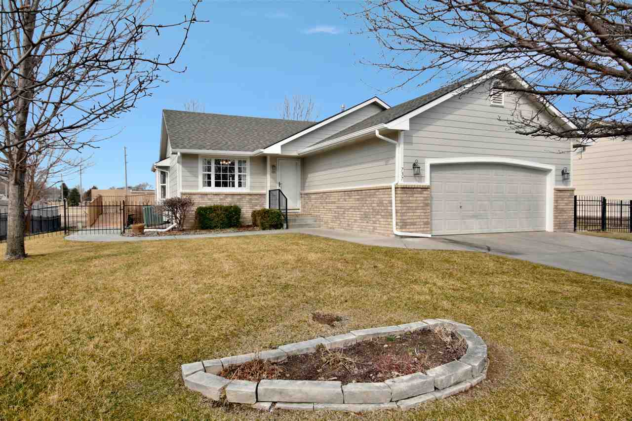 "Looking for a ""10"" in Andover-this is your home! CLEAN, move in ready, new exterior paint in 3/2021, no specials, no backyard neighbors and in the Reflection Lake neighborhood. Great location to all things in Andover and Wichita and located on a circle. Fantastic curb appeal and a warm and bright greeting as you enter the living room with vaulted ceilings and an open feel to dining and kitchen. Fresh neutral paint in most interior rooms. Dining has bay window, tile floors and open to kitchen with tile floors, eating bar, plenty of counter space and window to your private backyard. Master bedroom has ceiling fan, bay window to backyard, double closets and room for king sized furniture. Main floor bath has tile floors, tile shower, double sinks, access to master bedroom and is ADA compliant. Main floor also features separate laundry closet, bedroom with large closet and a chair lift to basement. Zero entry from garage via ramp access. Home was built completely ADA compliant in 2003. Basement has large family room, full bath and two additional bedrooms. Deck off dining room is composite and features a handicap ramp to backyard and a sidewalk that leads to the front of the home. Privacy and iron fencing in backyard, irrigation well and sprinkler system and lawn has been meticulously maintained. Neighborhood features playground and lake/pond. Call today to see this awesome home!"