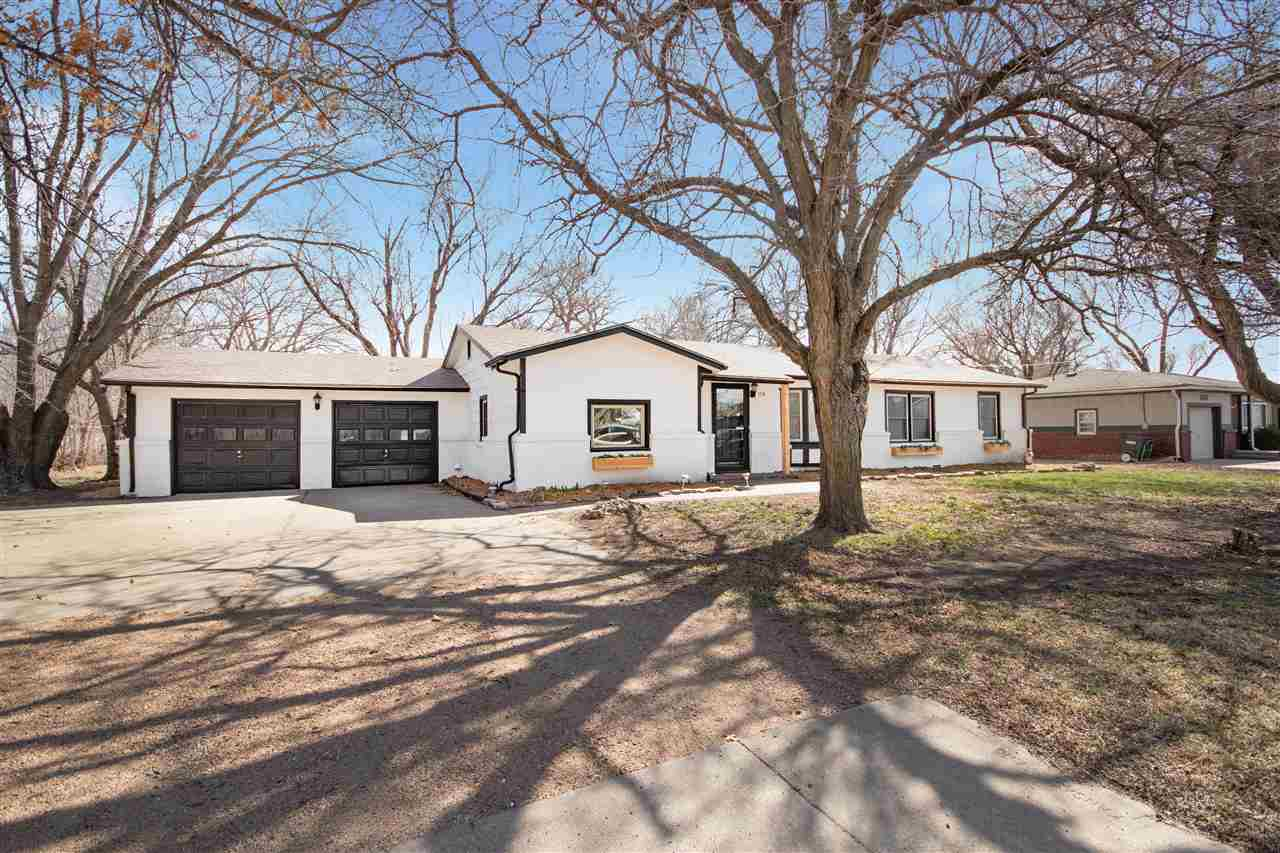 Come see this newly remodeled ranch home in the Goddard school district on .75 acres! This is a 4 be