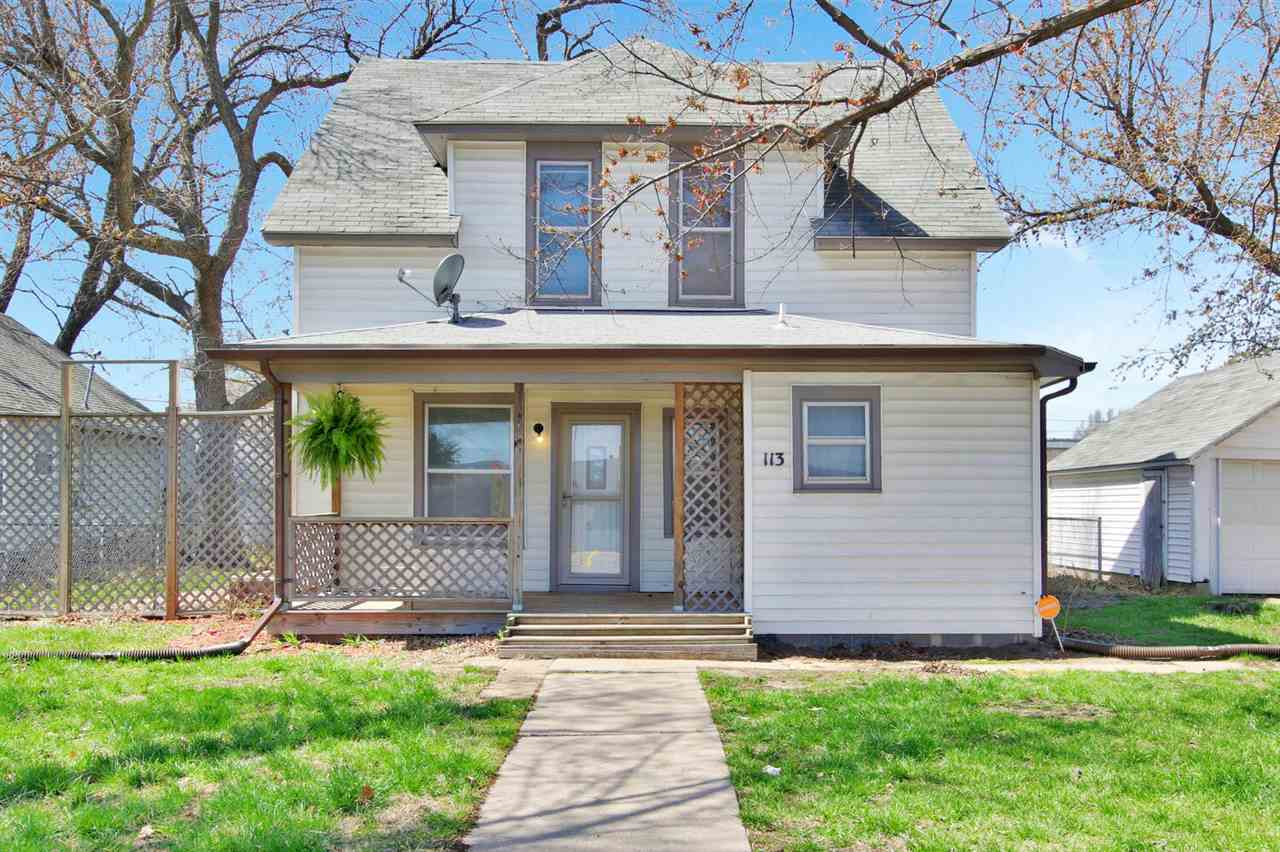 Don't miss your opportunity to make this darling house your home!  4 bedrooms with one on the main level and 3 upstairs.  Fresh paint throughout.  Updated kitchen comes with all appliances.  Both bathrooms have been completely renovated.  Nice built-ins and window seat add original charm to the updated interior.  New flooring in all the upstairs bedrooms.  Central heat and ac new in 2020.  All exterior trim freshly painted.  Fully fenced back yard with alley access and plenty of room for a large shed or garage.  Stop in to see it before it's gone!