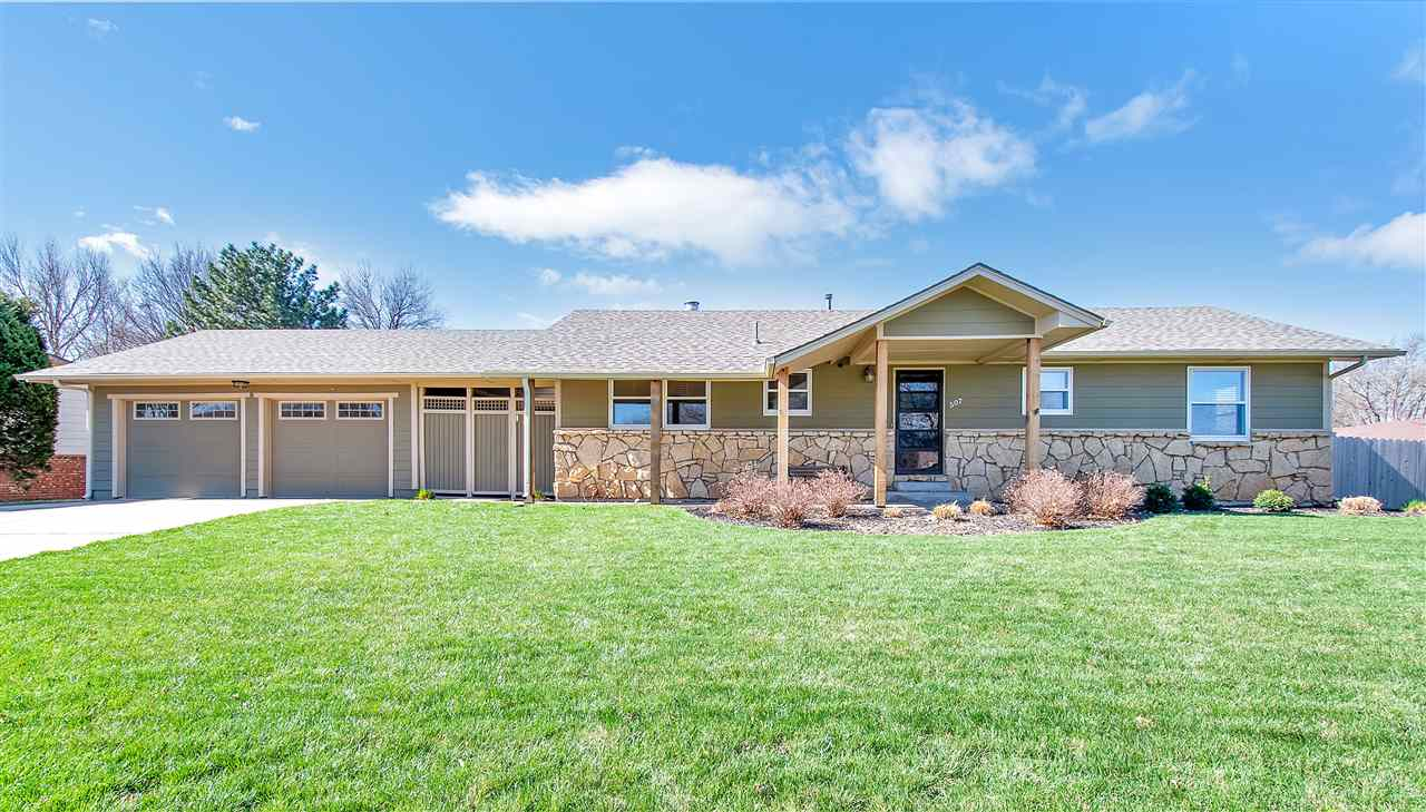 Very clean and well-kept home in Andale. Fenced back yard and covered breezeway make the back yard g