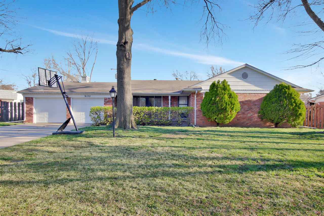 You don't want to miss this one! This adorable all brick home has a cute covered front porch and fea