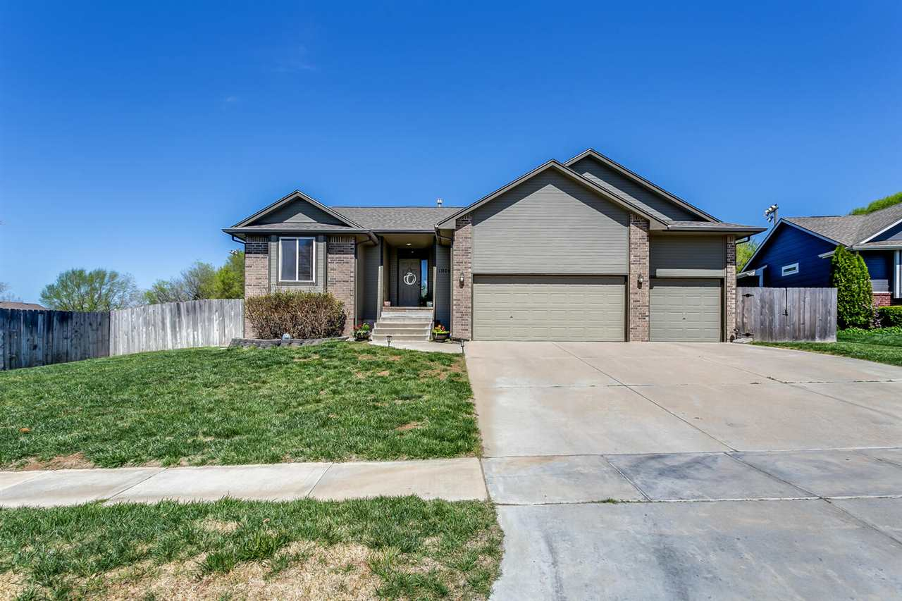 Welcome home!!! 4 bedroom, 3 bathroom with 3 car garage Derby ranch-style home with direct access (l