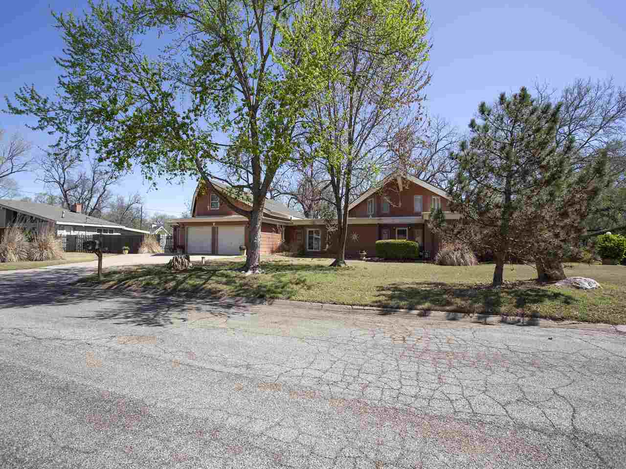 Beautiful unique home in West Wichita located on half acre with a water view. Total of 3 bdrms, 2 ba