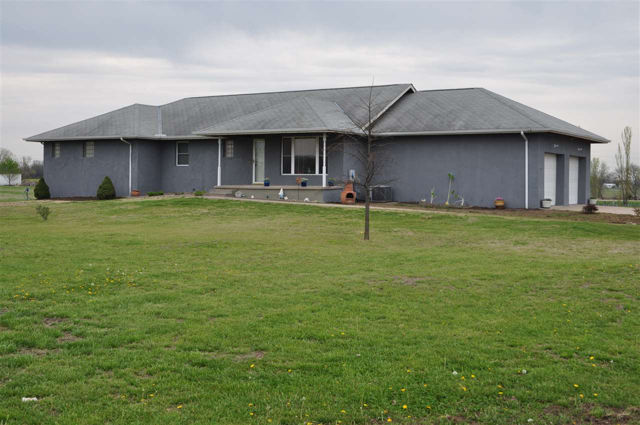 CUSTOM BUILT ENERGY EFFICIENT CONCRETE FOAM HOME SITUATED ON 5.35 ACRES IN DESIRED DERBY KS... THERE