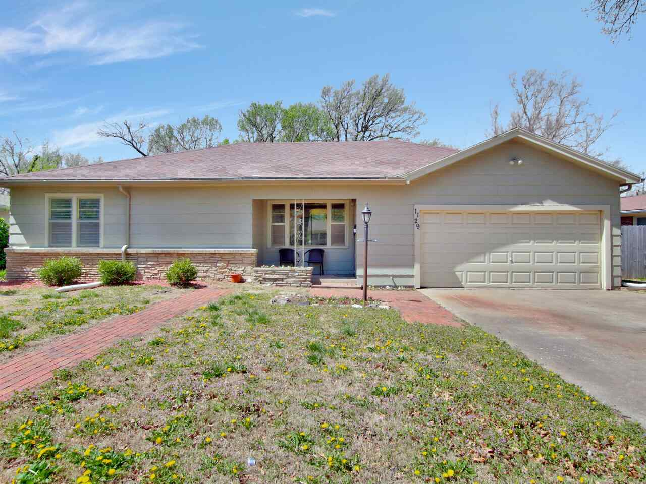 Beautiful, wide-open-concept ranch! Wood flooring throughout sprawling front living room and huge family room space. Gorgeous brick fireplace near wide spacious windows. Bright, white kitchen with eating space, tons of cabinets, and plenty of counterspace for cooking and entertaining! ALL APPLIANCES REMAIN! Main bedroom is unusually large with extensive closet and storage space. Master bathroom is updated with double sinks and corner shower. Hall bathroom is roomy and bright with tub & shower combo. Separate mud room and laundry space right around the kitchen space, next to 2-car garage is more conenient than most homes! Large, fully-fenced backyard with mature trees for shade and nice brick patio for relaxing any time of day... You'd better see this home today!