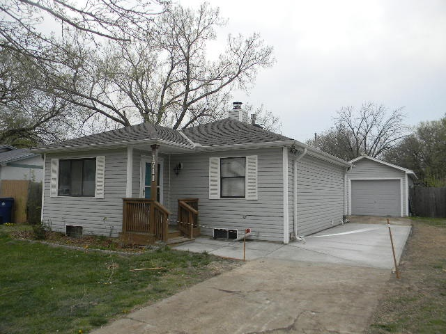 2 Bedroom, 1 Bath Ranch Home with unfinished basement and 1-Car oversized Garage. The exterior of th