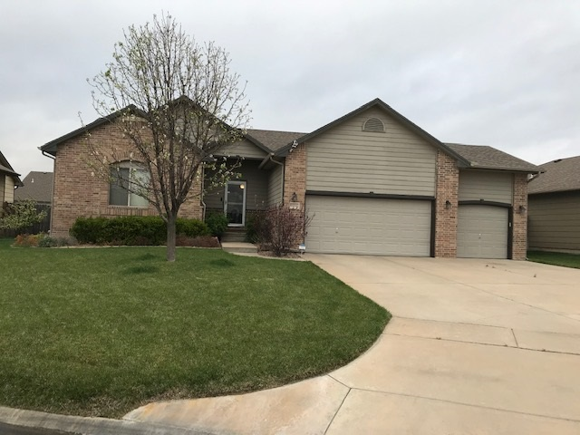 Great curb appeal with a corner tree lined lot in Tyler's Landing Addition and the Maize South Schoo