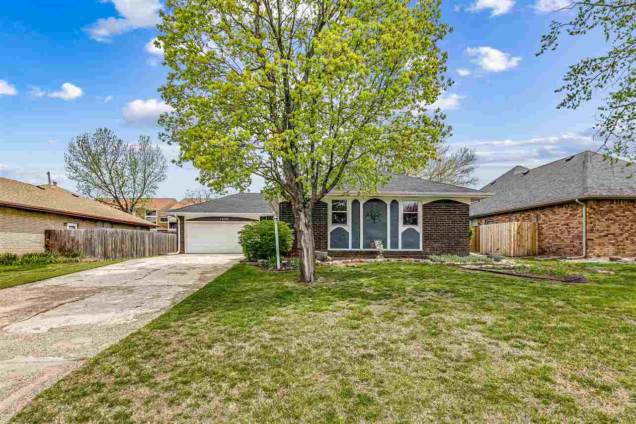 ALL-BRICK Ranch with 3 bedrooms, 2.5 baths & attached 2-car garage. Very well-cared-for and UPDATED