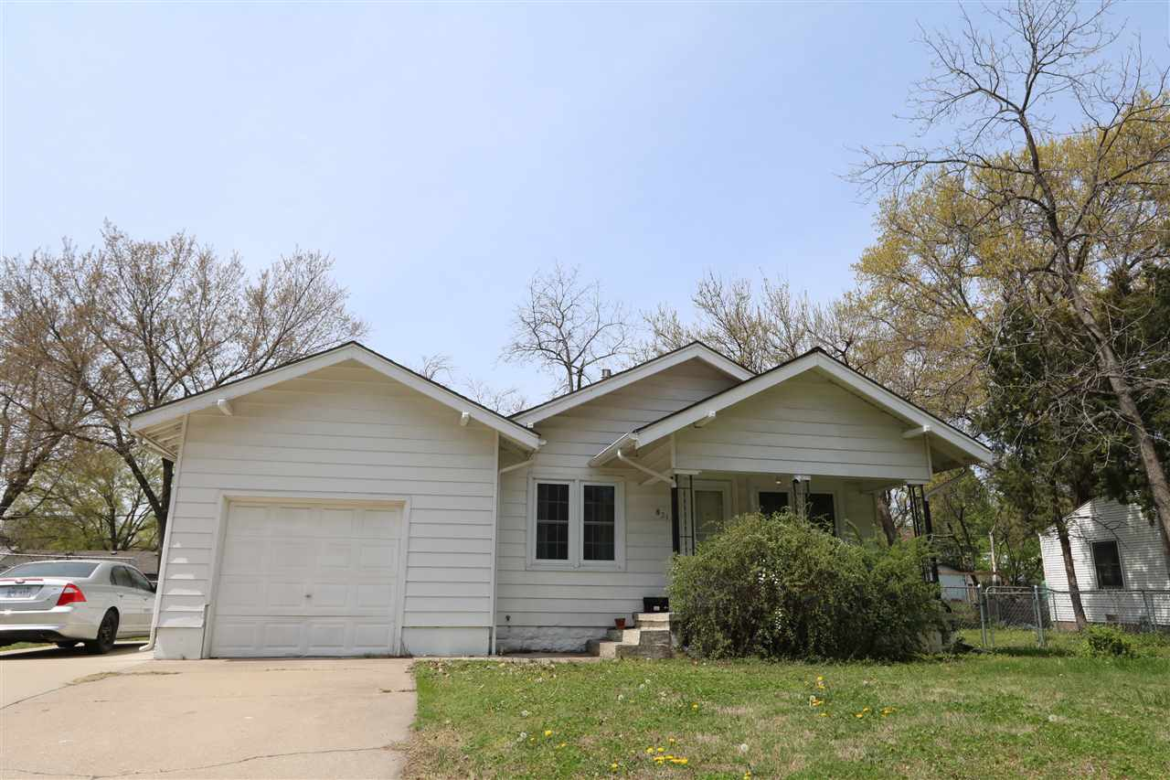 2 bedroom, 1 bath with an unfinished basement home for sale. Updated newer vinyl windows. New floori