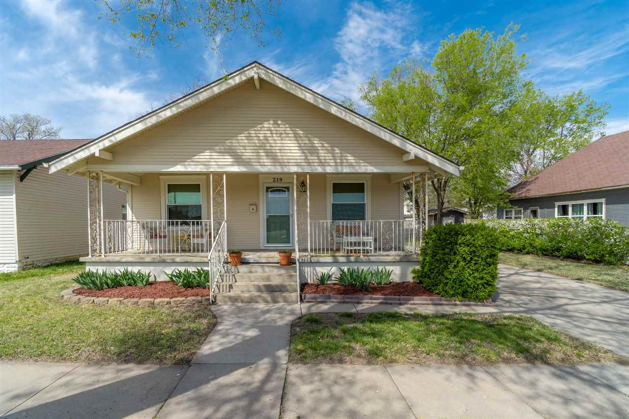 Quaint cottage in the Delano District awaits its new owner.  Large front porch, open floorplan with
