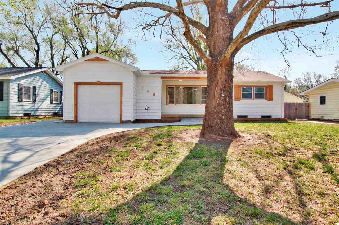 This darling & totally remodeled home has 3 bedrooms, 1 bonus room and 2 full baths with a huge fenc