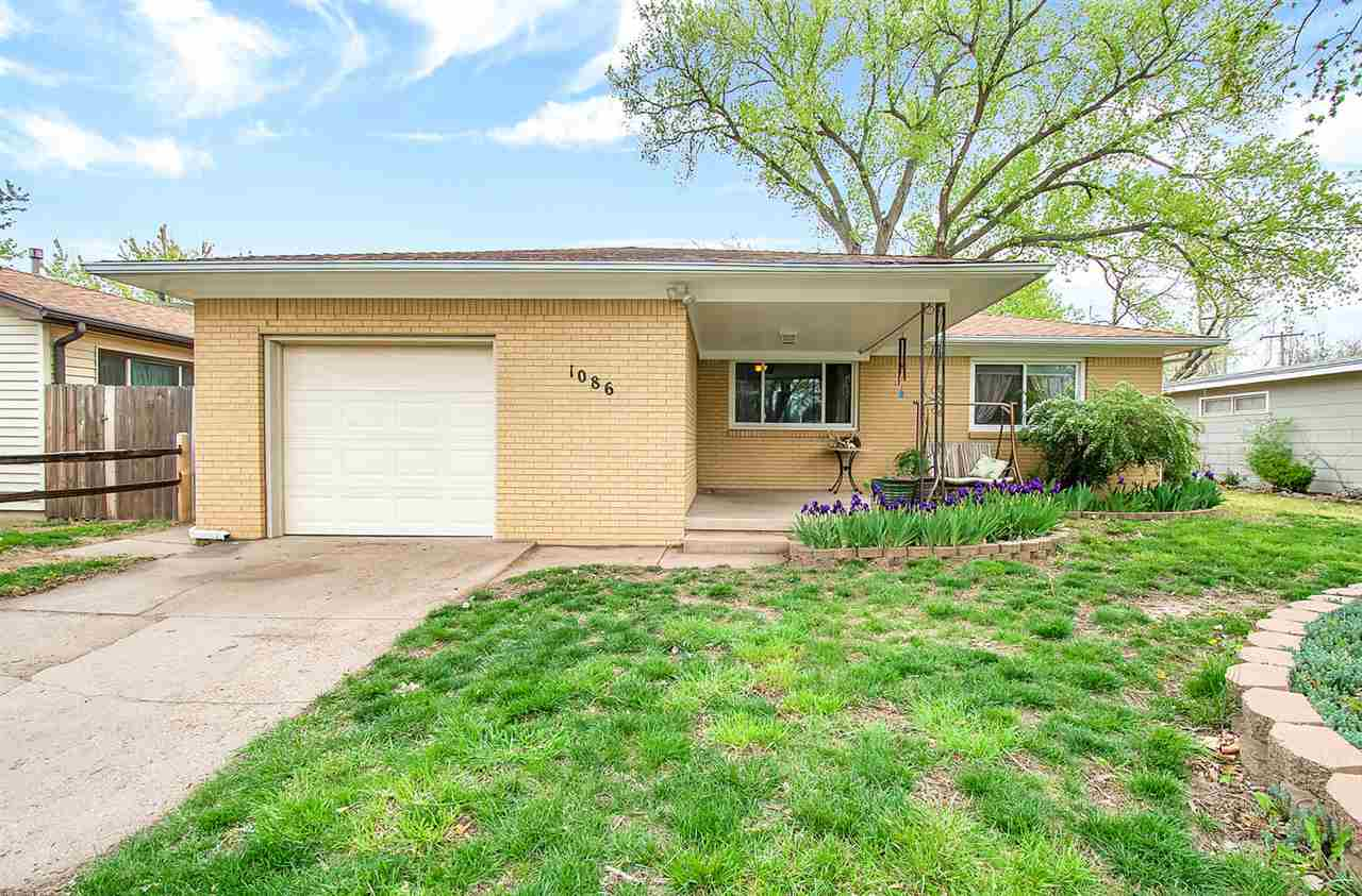 Located in West-Central Wichita, this charming brick home is minutes away from the Sedgwick County Z