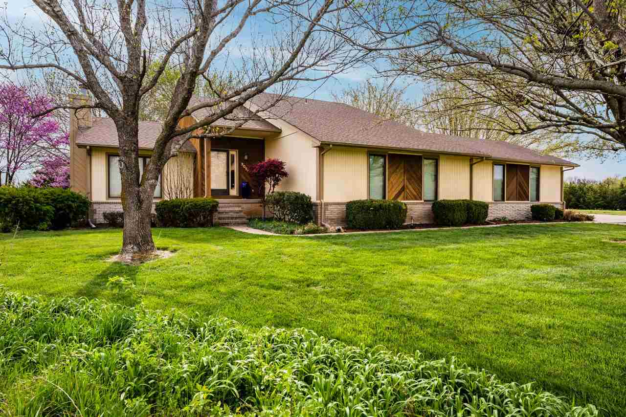 Country living just minutes from the Wichita, Rose Hill, and Derby...this warm and inviting home is