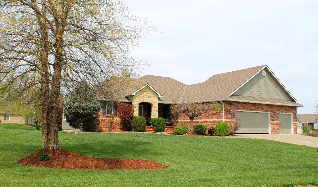 When you drive up to this five bedroom, 3 bath home the nicely landscaped yard with sprinkler system