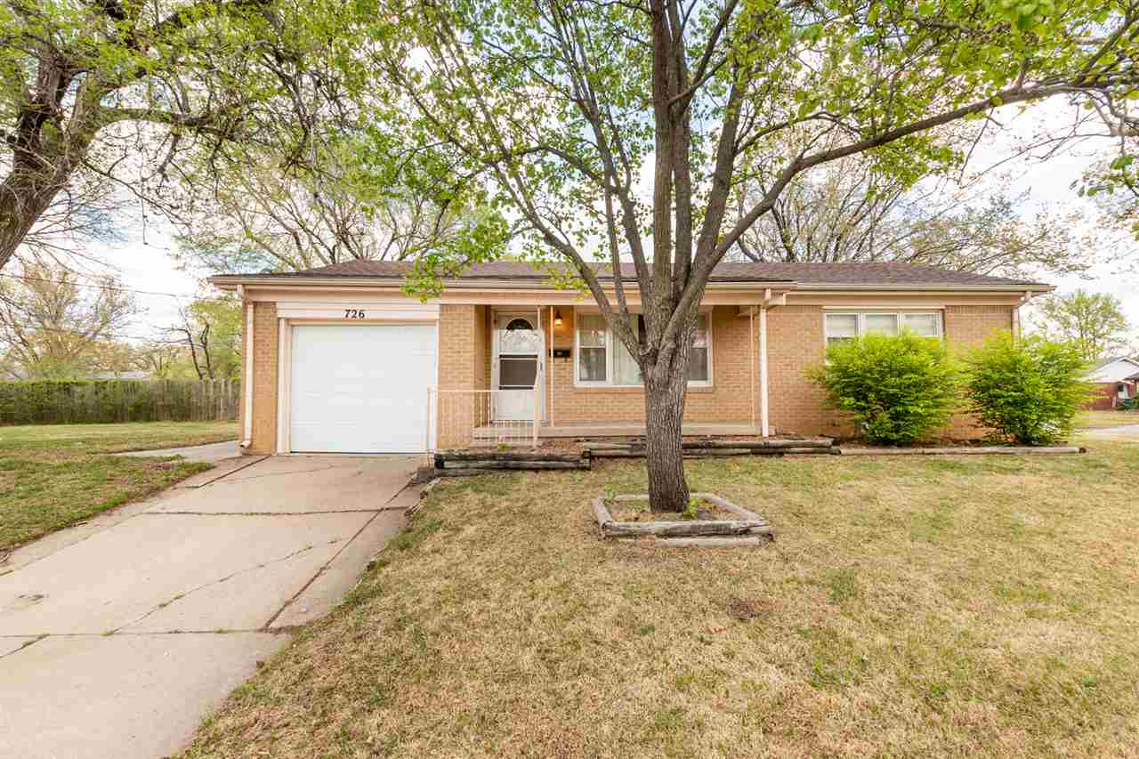 Welcome Home to this adorable, clean, all brick ranch style home in Southeast Wichita! Hardwood floo