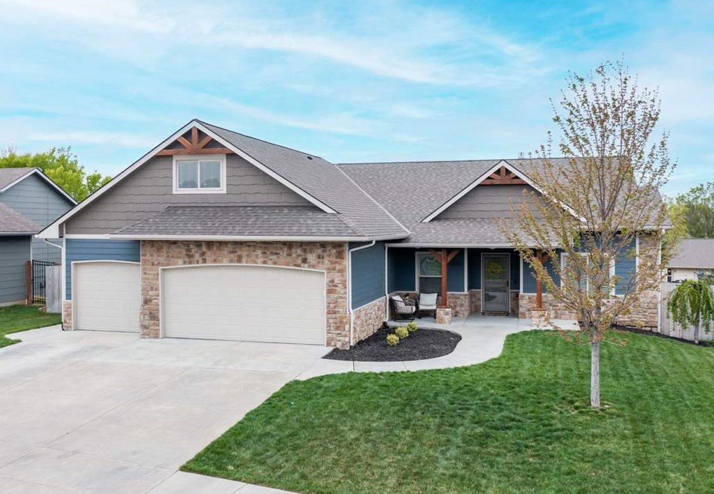 Wow! Welcome to this beautifully designed custom home in the Derby school district. This home includ
