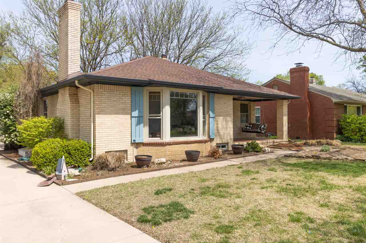 Updated ranch home in desirable Crown Heights! This home features large living room with wood floori