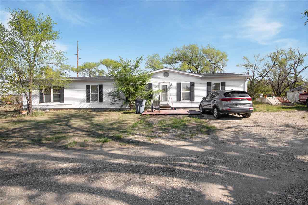 East side home on nearly an acre of land with easy access to shopping, dining, and entertainment! Th