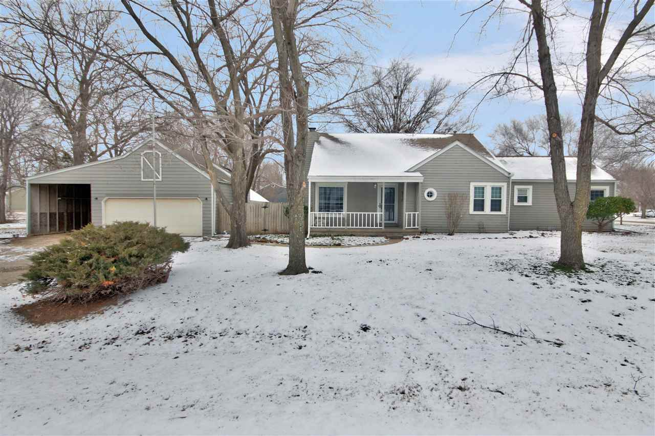 Adorable 3 bed 1 bath home in Rose Hill located on almost half an acre with a huge oversized garage and side load plus work shop space in the garage! This cute home has new laminate flooring in the living spaces. Cozy living space with a wood burning fireplace plus a formal dining room off of the kitchen. The spacious bedrooms feature walk in closets. Updated bathroom with two sinks! New beautiful blinds throughout the home. Enjoy peaceful country living on this private wooded corner lot with a privacy fence. Home is being sold in AS IS condition.