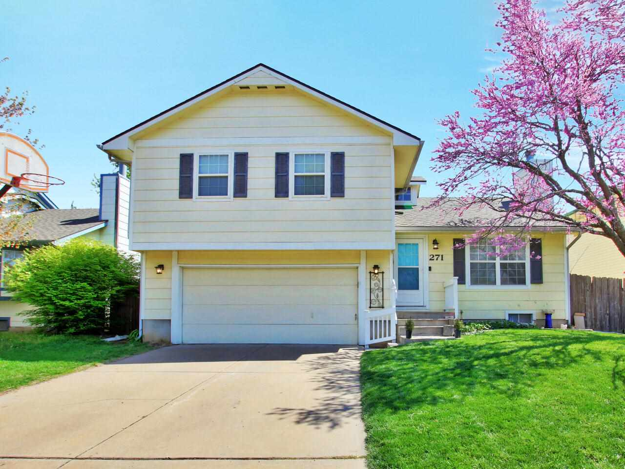 Great family home in Derby. Family Room in Basement with 1/2 bath. Big backyard with a patio, fire pit and playset. Attached oversized 23x26 garage.