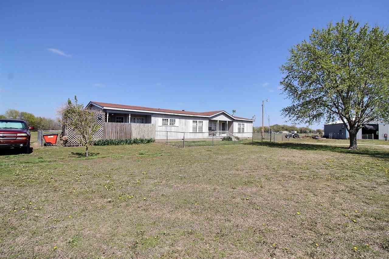 ALMOST 5 ACRES with a 3-bedroom, 2-bath home from 1993 and offering 1904 square feet of single floor