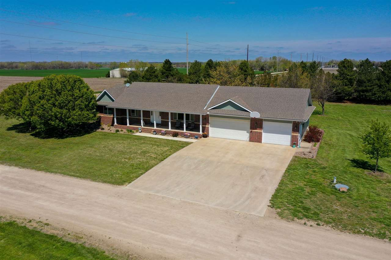 15 Acre Ranchette with well appointed home South of Newton and easy access to I-135 and Highway 15.
