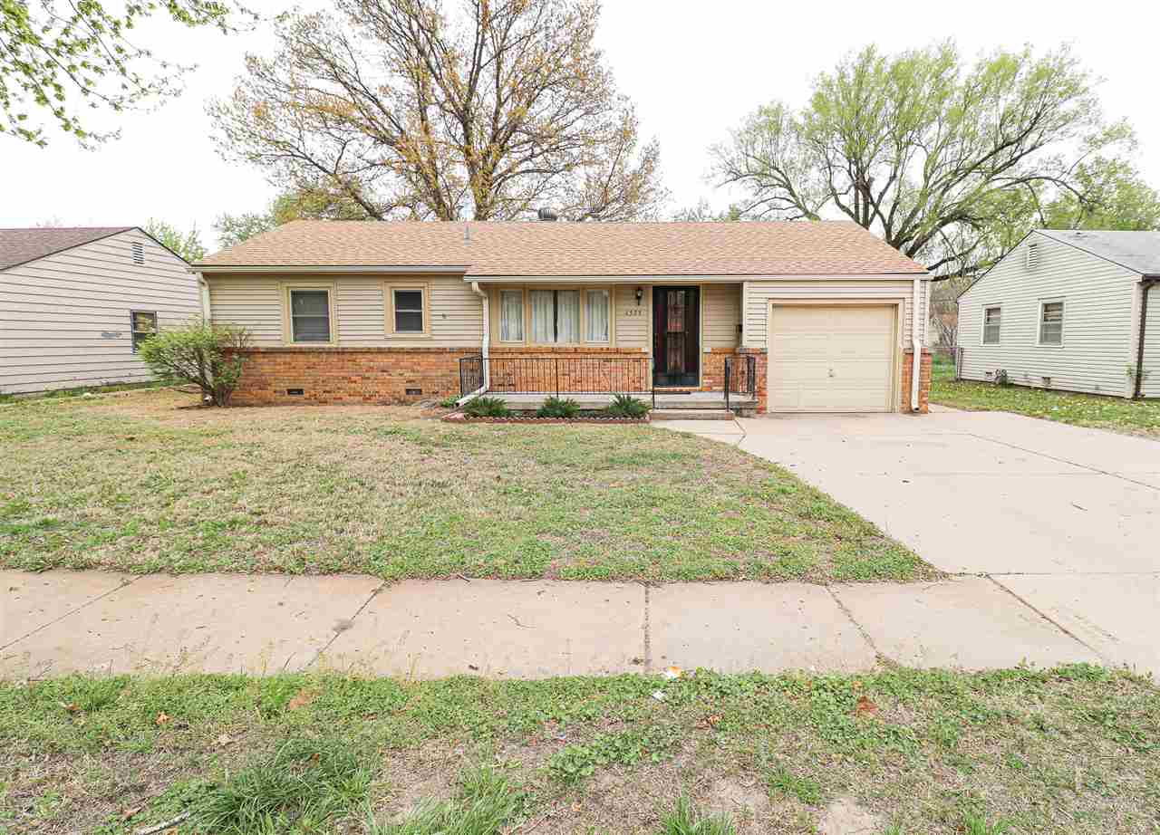 Move-In Ready Ranch with Large Workshop.  3 Bed/1 Bath.  Hardwood floors throughout most of the home
