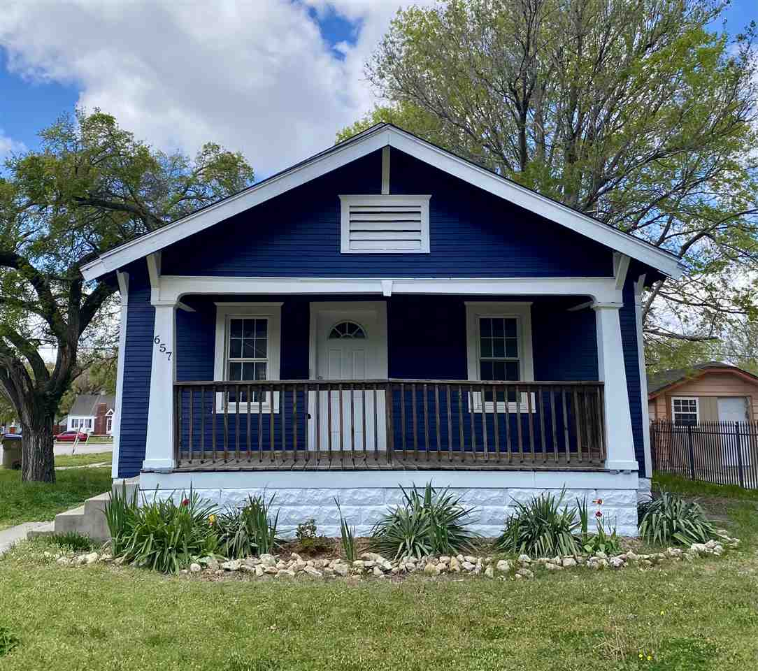 Affordable and attractive 2 bed 1 bath corner lot with detached garage and large fenced in backyard
