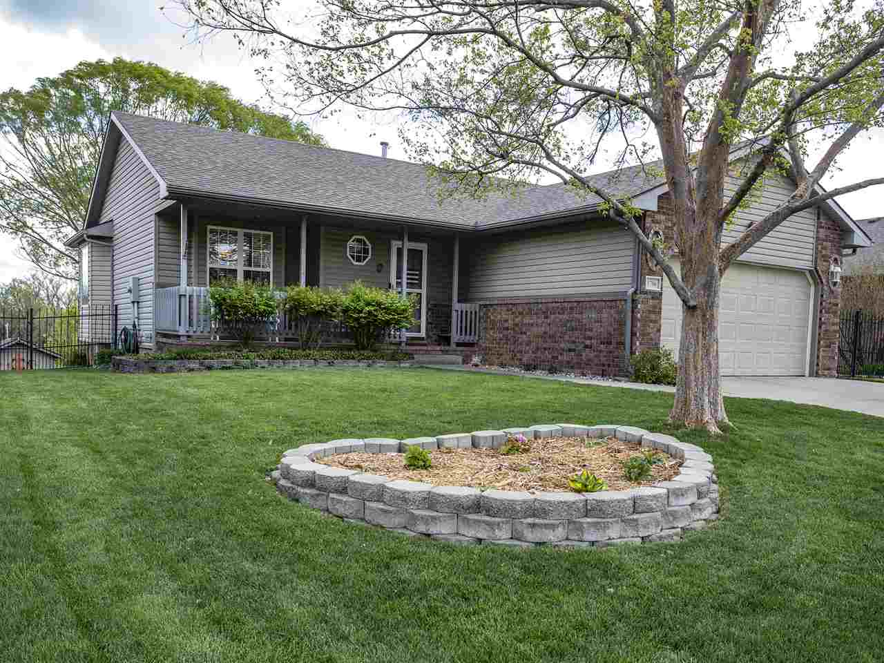 Come see this wonderful home with low maintenance permanent siding and walkout basement that backs t