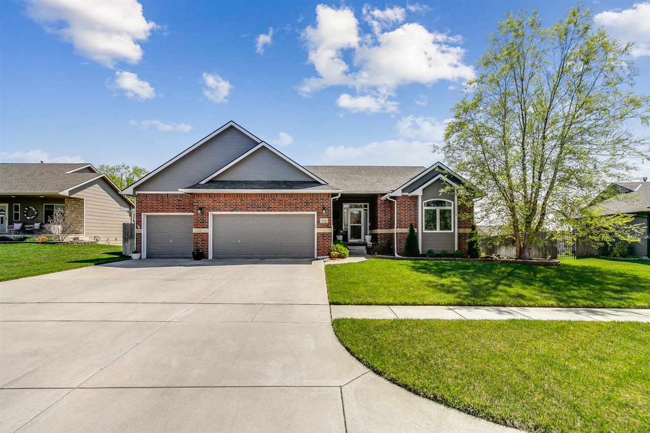 This wonderfully maintained ranch home in Derby features a freshly painted exterior, professionally