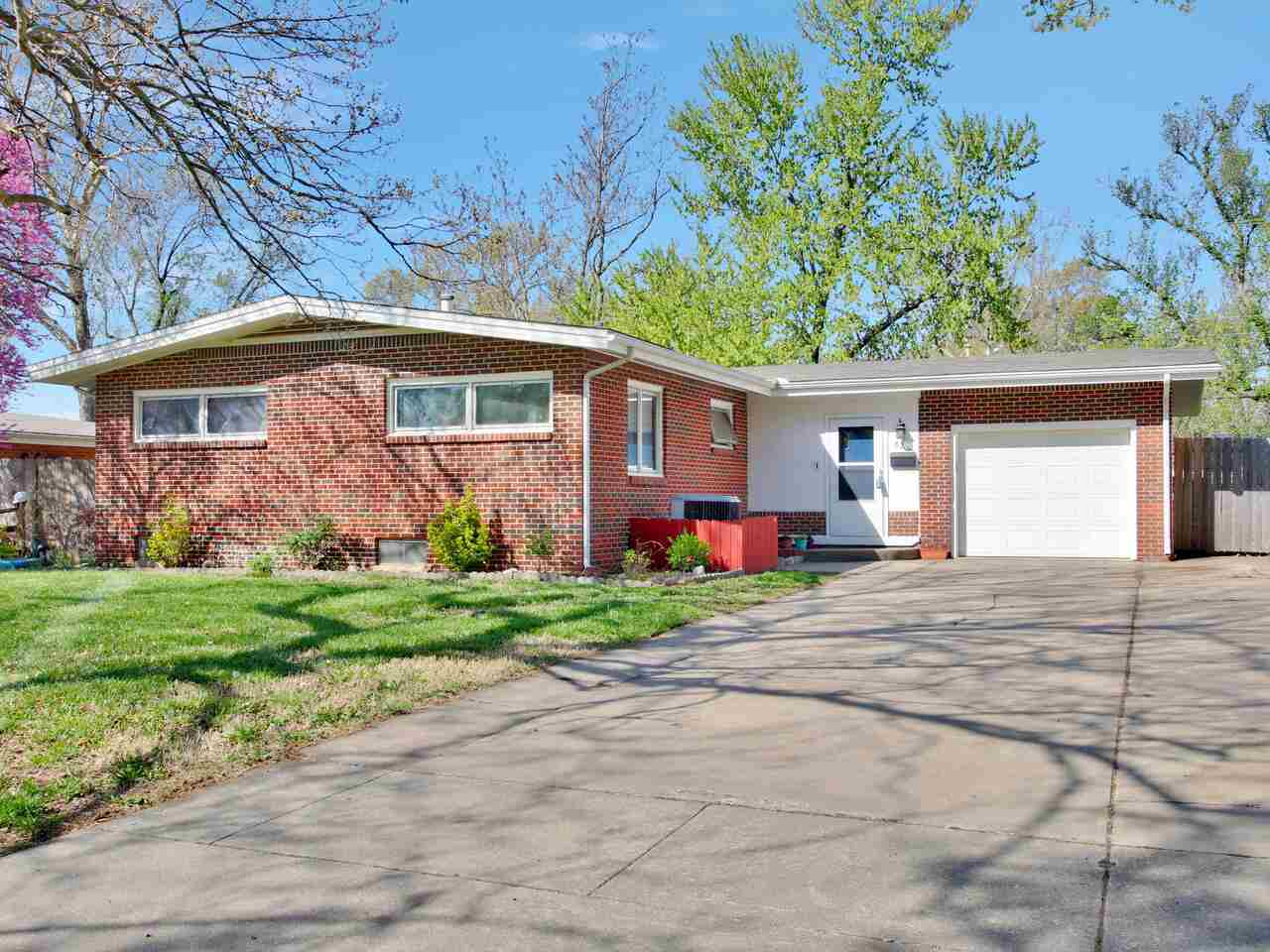 Mid-Century modern  full brick 3 bedroom 2 bath home with basement in the sought after Westlink Neig