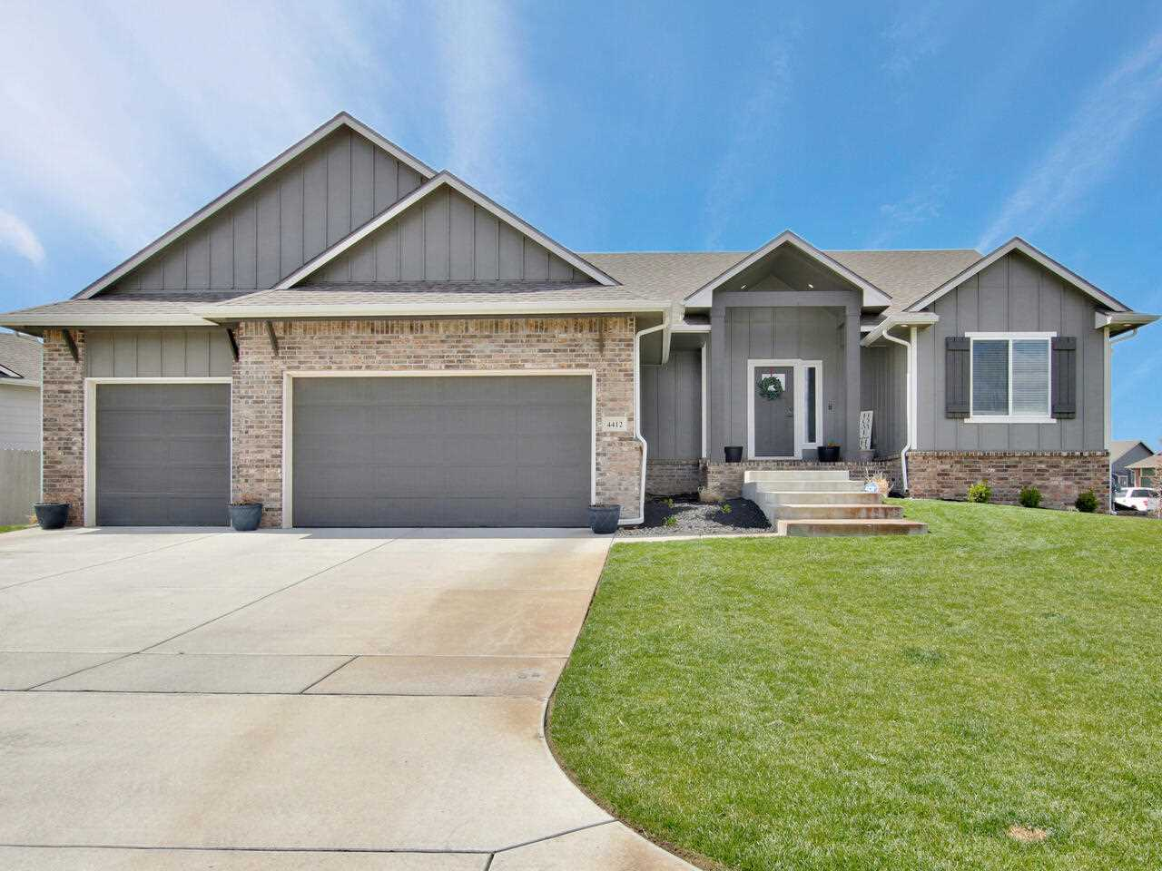 Beautiful custom home in Edgewater and Maize School District. Move-in ready with a Farmhouse feel. 5