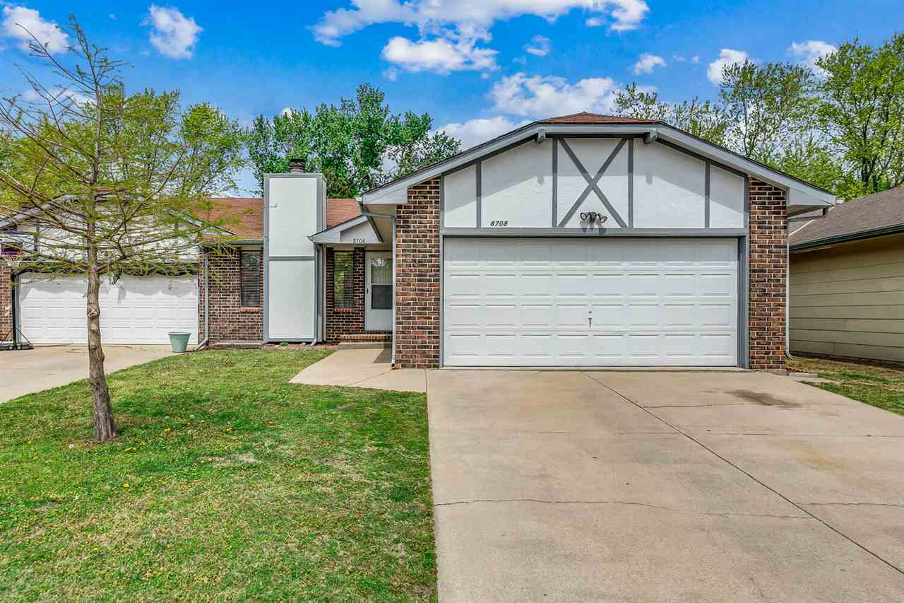 SPACIOUS WEST SIDE DUPLEX FEATURES THREE BEDROOMS, TWO BATHROOMS, AND A TWO CAR GARAGE! OPEN CONCEPT