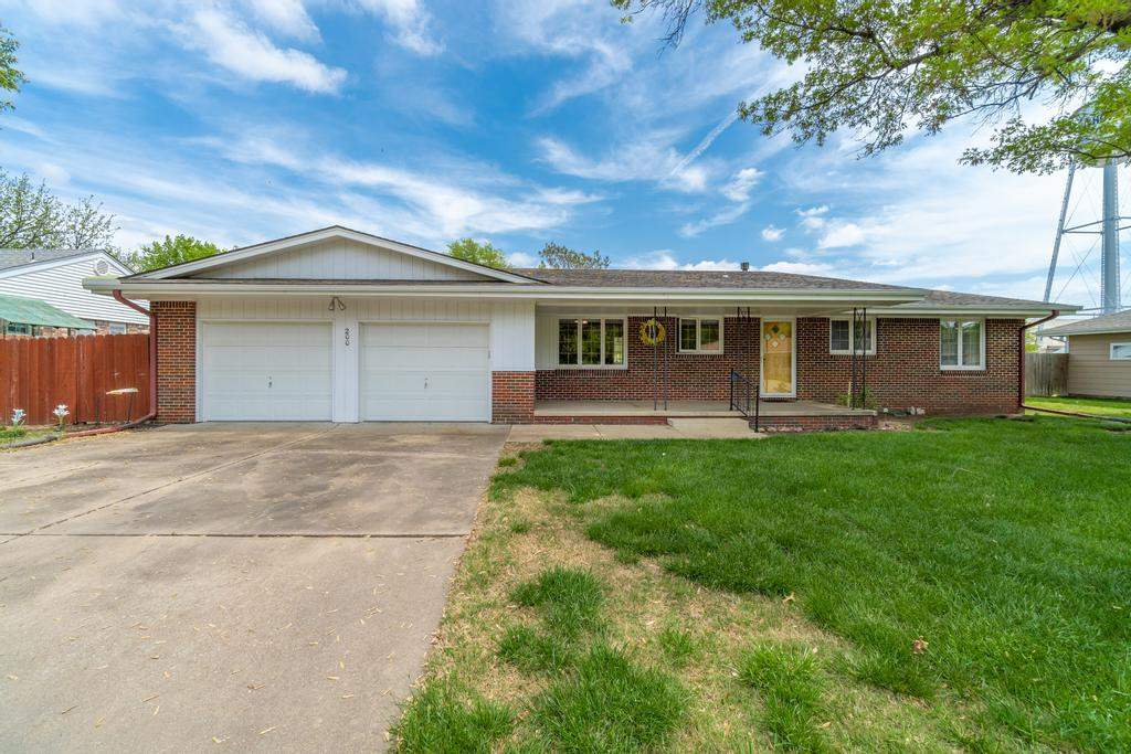 Welcome home to this near pristine 2bed/2bath/5-car mostly-brick ranch in quiet Mount Hope, KS. This