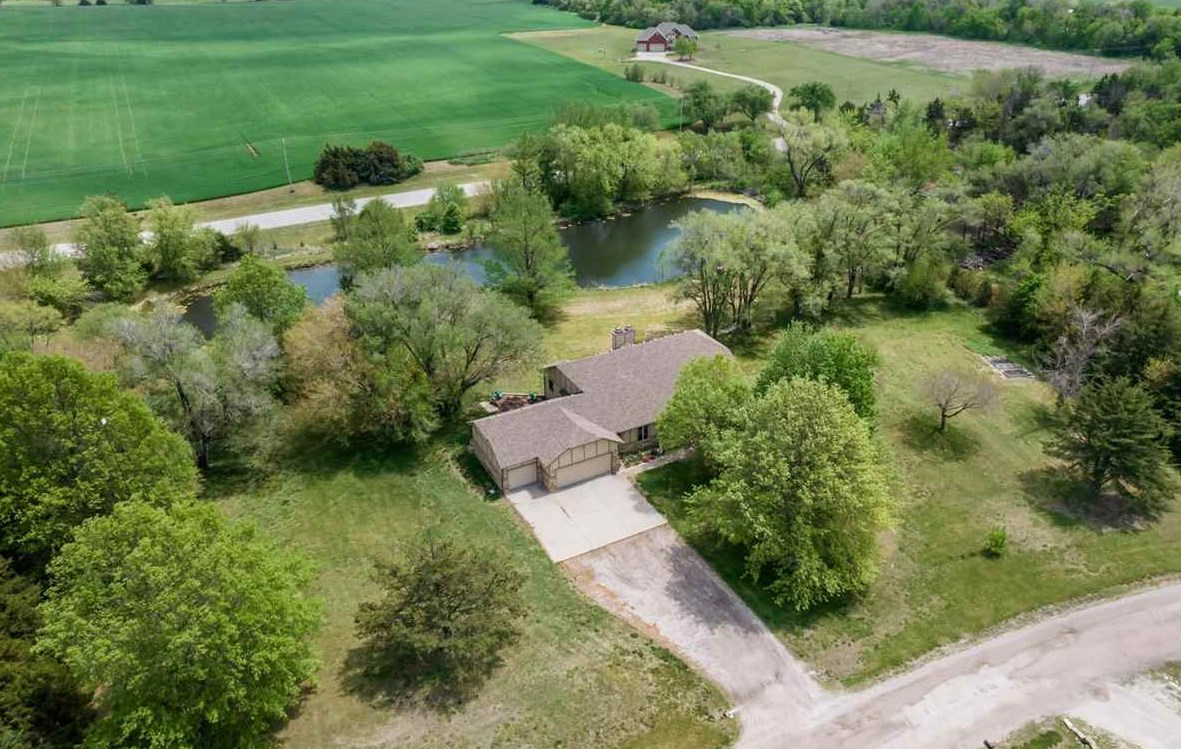 WOW! This gorgeous home sits on an incredible 3 acre property with it's own private pond! The minute