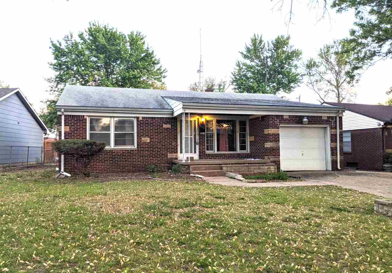 All brick home with wood floors, new kitchen cabinets, new bathroom, new flooring downstairs. Full f