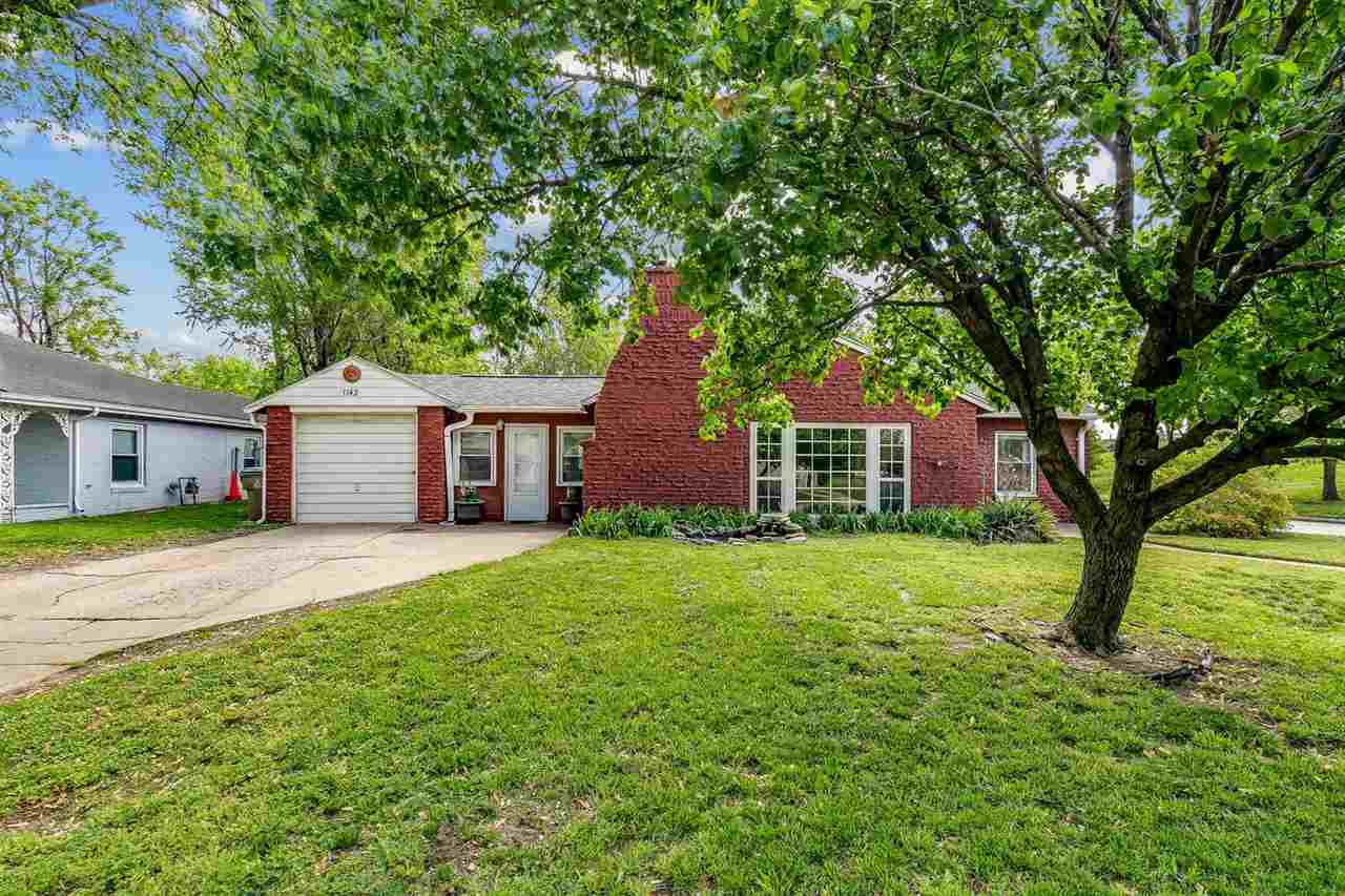 This charming, all brick home offers loads of character!  You are greeted at the front door by a fun