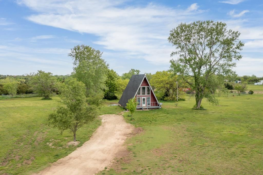 Unique A-Frame home situated on almost 5 acres moments away from Rock Road and Madison in Derby! Her