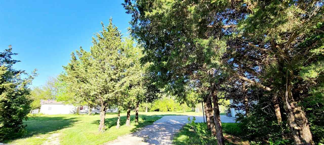 Secluded slice of country!  4 bed 2.5 bath manufactured home on 3.3 acres with a detached 2 plus car