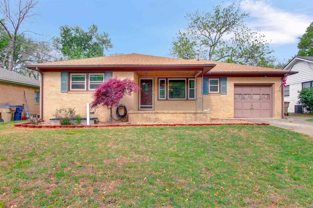 In great small town living is this move-in ready 3 bedroom brick home, newly installed wood laminate
