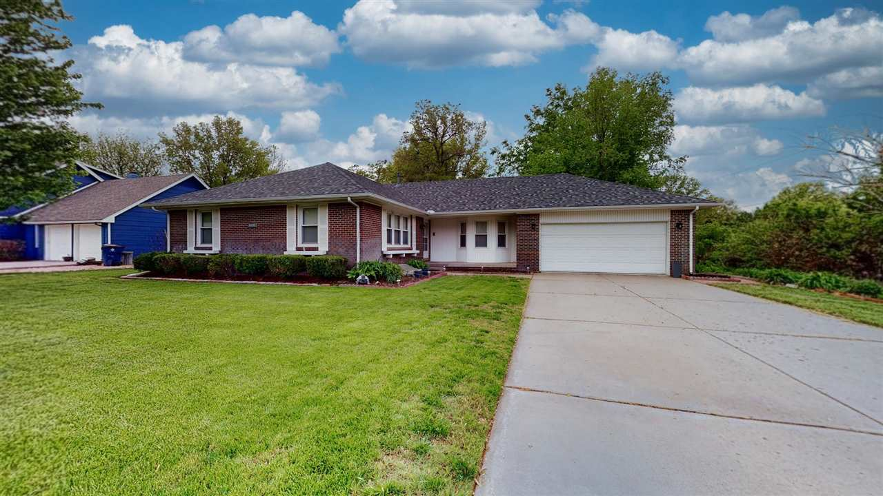 Wonderful all brick ranch home in the Goddard School District. Main floor laundry, spacious kitchen,